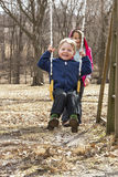 Happy young boy on swing Stock Image
