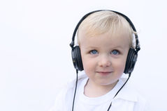 Happy young boy wearing headphones Royalty Free Stock Photos