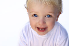 Happy young boy on white background. Big blue eyes Royalty Free Stock Photography