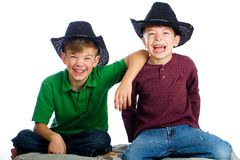 Happy young boys. Two young boys with happy expressions on their face royalty free stock photography