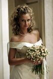 Happy young bride. Half body portrait of smiling young bride with bouquet of flowers stock photography