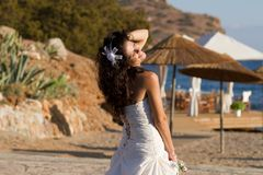Happy young bride on the beach Royalty Free Stock Images