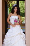 Happy young bride with bouquet Stock Photo