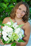 Happy young bride with bouquet Stock Images