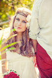 Happy young bride leaning on his strong shoulder. Beautiful girl leaning on a guy Stock Photography