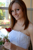 Happy young bride with rose royalty free stock image