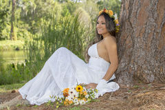 Happy Young Bride Sitting By A Tree Royalty Free Stock Image