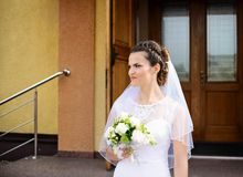 Happy young Bride standing in front of the church Stock Photos