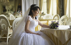 Happy young bride with wedding bouquet. For your Stock Photography