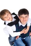 Happy young brothers hugging. Two happy young brothers embracing, isolated on white background stock photo