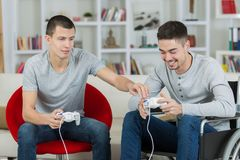Happy young brothers playing video games. 2 stock images