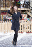Happy young brown haired woman on the background of a winter amu Royalty Free Stock Photography