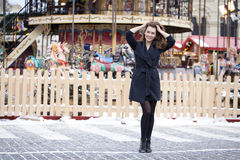 Happy young brown haired woman on the background of a winter amu Stock Photo