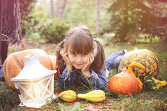 happy young brunete girl lying on the ground Stock Images