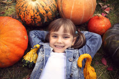Happy young brunete girl lying on the ground Royalty Free Stock Photography