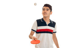 Happy young brunett sportsman practicing ping-pong isolated on white background. Happy young brunett sportsman practicing ping-pong isolated on white stock photo