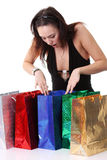 Happy young brunette girl with colorful shopping bags in sexy dr Stock Photo