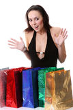 Happy young brunette girl with colorful shopping bags in sexy dr Stock Image