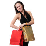 Happy young brunette girl with colorful shopping bags in sexy dr Stock Photos