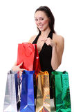 Happy young brunette girl with colorful shopping bags in sexy dr Stock Photography