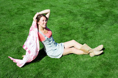 Happy young brunette with a handkerchief resting Royalty Free Stock Images