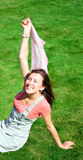 Happy young brunette with a handkerchief resting Stock Photos