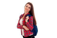 Happy young brunette student with blue backpack on her shoulders smiling on camera isolated on white background Stock Photos