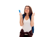 Happy young brunette students teenager in stylish clothes and backpack on her shoulders posing isolated on white Stock Photos