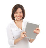 Happy young brunette using a touchpad Royalty Free Stock Images