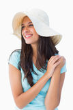 Happy young brunette wearing sunhat Royalty Free Stock Photography