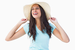 Happy young brunette wearing sunhat Stock Photo