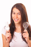 Happy young brunette woman with electric lamps Royalty Free Stock Photos
