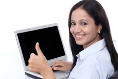 Happy young buisiness woman showing thumbs up Stock Photo