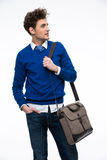 Happy young business man with bag looking away Stock Photography
