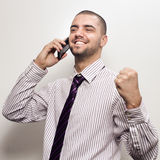 Happy young business man celebrating Stock Photography