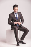 Happy young business man closing his jacket Royalty Free Stock Images