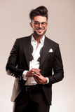 Happy young business man fixing his golden ring Stock Image