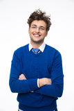 Happy young business man in glasses with arms folded Royalty Free Stock Images