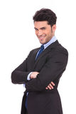 Happy young business man with hands crossed smiling Stock Photos