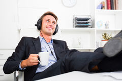 Happy young business man listening to music Stock Photography