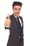 Happy young business man making the ok hand sign royalty free stock images