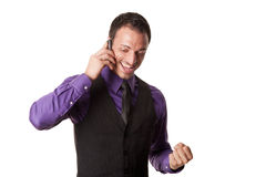 Happy young business man on mobile phone Stock Photos