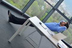 Happy young business man at office Royalty Free Stock Images