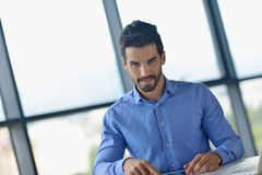 Happy young business man at office Royalty Free Stock Photography