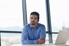 Happy young business man at office Stock Photography
