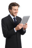 Happy young business man reading a tablet reader. Isolated on a white background Royalty Free Stock Image