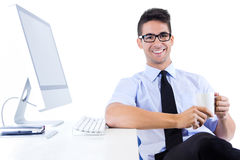 Happy young business man relaxing  in modern office Stock Photography