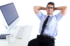 Happy young business man relaxing  in modern office Royalty Free Stock Image