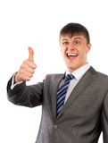 Happy young business man showing thumbs up Stock Photos