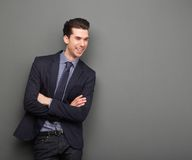 Happy young business man standing with arms crossed Stock Photos